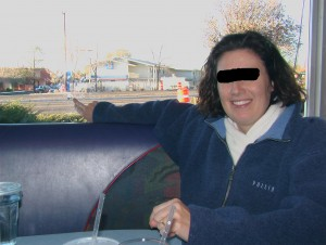 US Trip 2008 - Sharon with Bullet Hole in Diner's Window (edited)