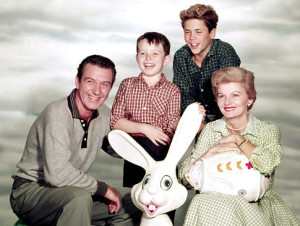 The cast of the CBS family sitcom 'Leave it to Beaver,' American actors (left to right) Hugh Beaumont (1909 - 1982), Jerry Mathers, Tony Dow and Barbara Billingsley, pose ofr a publicity photo in an Easter setting, 1957. (Photo by CBS Photo Archive/Getty Images) Original Filename: 53232596.jpg
